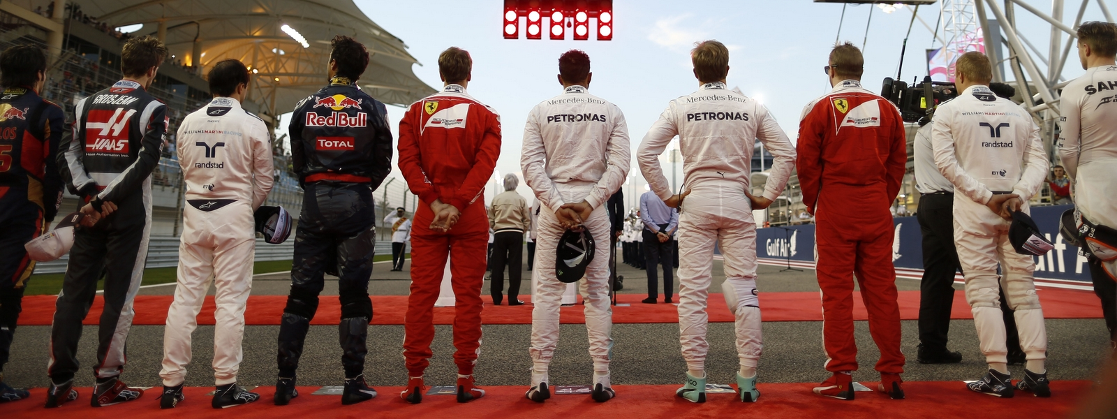 Motorsports: FIA Formula One World Championship 2016, Grand Prix of Bahrain,  F1 drivers during national anthem *** Local Caption *** +++ www.hoch-zwei.net +++ copyright: HOCH ZWEI +++