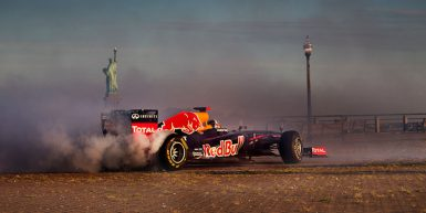 Red-Bull-Racing-F1-Car-donuts-in-front-of-Statue-of-Liberty